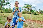 Family drinking through straws from coconut, Bonito, Mato Grosso do Sul, Brazil, South America