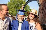 Teenage boy and family at graduation ceremony