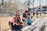 Schoolgirl soccer team preparing at school sports field