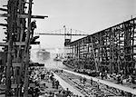1900s JUNE 19 1915 LAUNCHING OF BATTLESHIP ARIZONA FROM BROOKLYN NAVY YARD INTO EAST RIVER WITH WAITING TUG BOATS NYC USA
