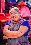 Portrait of smiling, female vendor at the Tianguis de los Martes (Tuesday Market) in San Miguel de Allende, Mexico