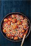 close up of rustic meatball spaghetti in tomato sauce