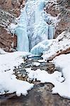 Icy waterfall near Falzarego pass, Ampezzo Dolomites natural park, Cortina d' Ampezzo, Belluno, Veneto, Italy