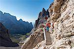 "Sesto / Sexten, province of Bolzano, Dolomites, South Tyrol, Italy. Climbers on the via ferrata ""Passaporto"" at the Mount Paterno"