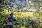 A girl looking at Lake Konigsee, Berchtesgaden Land, Bayern, Germany.