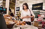 Woman choosing food in bakery