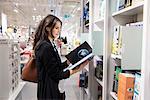 Woman choosing books in store