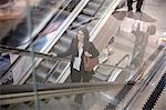 Woman on escalator in shopping center