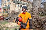 Arborists holding protective helmet