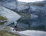 Man fishing in lake Fjerddalsvatnet
