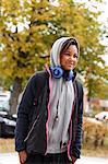Girl in hoodies with headphones