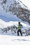Skier on mountain in Piedmont, Italy