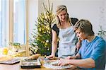 Couple preparing christmas cookies