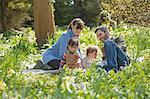 Happy Family Sitting in Garden