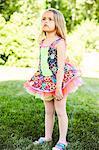 Young Girl Standing in Garden Sulking