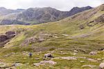 Hiker Climbing Mountain Valley