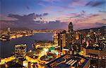 Hong Kong skyline just before sunrise looking from Hong Kong Island across Victoria Harbour to Kowloon, Hong Kong, China, Asia