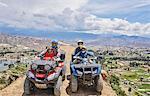 Family on top of mountain, using quad bikes, La Paz, Bolivia, South America