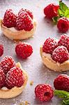 Raspberry tarts with sugar