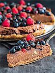 Raw vegan gluten-free chocolate tart with berries