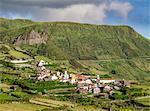 View towards Mosteiro Village and Rocha dos Bordoes, Flores Island, Azores, Portugal, Atlantic, Europe