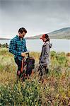 Couple standing beside Dillon Reservoir, Silverthorne, Colorado, USA