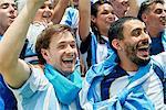 Argentinian football fans watching football match