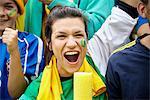 Brazilian football fan cheering at match