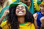 Brazilian football fans cheering at match
