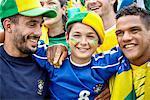 Brazilian football fans bonding at match, portrait