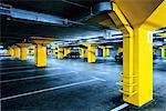 Underground garage parking lot with few cars.