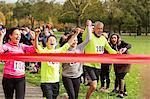 Enthusiastic family running, nearing charity run finish line