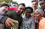 Friend runners taking selfie at charity run