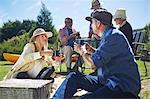 Active senior friends enjoying sunny summer picnic