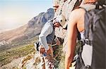 Male rock climber checking equipment