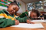 Two young girls writing at a desk, Meyerton Primary School, Meyerton, Gauteng