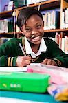 A young girl in school uniform sitting at a desk, Meyerton Primary School, Meyerton, Gauteng