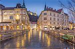 View from Plaza Presernov over Triple Bridge toward Ljubljana Castle, Ljubljana, Slovenia, Europe