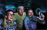 Designers viewing data on futuristic hologram screen