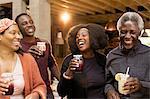 Happy multi-generation family drinking lemonade and sangria