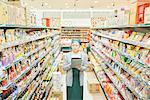 Senior woman checking restock in supermarket