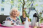 Senior woman at breakfast table