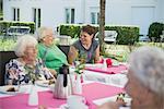 Senior women with nurse on breakfast table