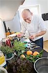Chef preparing lentil salad in private kitchen