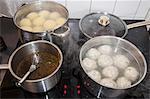 Cooking pots with bread dumplings, potato dumpling and sauce