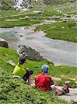 Hikers taking rest near Gave De Gaube river, Cauterets, France