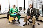 Caucasian man office super hero with his advisor, a black business man.