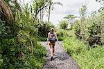 Young female tourist walking path near Victoria Falls, Zimbabwe, Africa