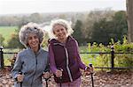 Portrait smiling, confident active senior women friends hiking with poles