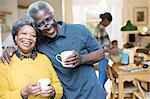 Portrait smiling, affectionate senior couple drinking coffee